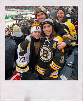 Kevin Woldahl with wife and a male and female friend smiling at hockey game